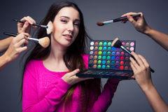 Cute make-up artist holding her vast palette of colors Stock Image