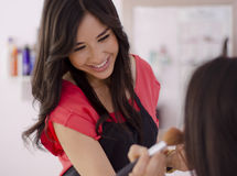 Cute makeup artist loving her job Stock Photos