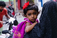 Cute maldivian girl on mother's hand looking back Stock Photography