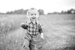 Cute male child, mouth open smiling. Black and white Stock Photography