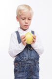 Cute male child prefers to eat healthy food stock images