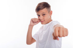 Cute male teenager is developing combat skills Stock Photography
