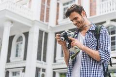 Cute male tourist watching made shots Stock Image