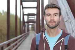 Cute male walking through a bridge.  Royalty Free Stock Photography