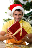 Cute man with Christmas gift stock photography