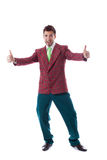 Cute man in colorful costume showing thumbs up Royalty Free Stock Image