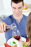 Cute man dining with his girlfriend at home Royalty Free Stock Image