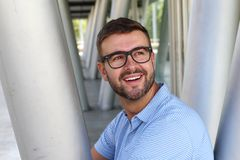 Cute man with glasses smiling stock photos