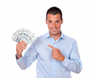Cute man holding and pointing his savings Royalty Free Stock Images