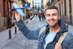 Cute man holding a toy airplane stock photography