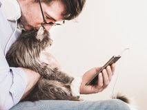 Cute man and cute kitten royalty free stock image