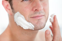 Cute man preparing to shave in the bathroom stock image