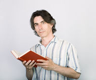 Cute man reading a book Royalty Free Stock Photo