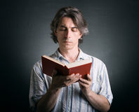 Cute man reading a book Royalty Free Stock Image