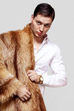 Cute man in a red fox fur coat Stock Photography