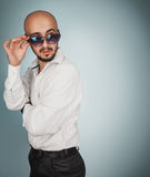 Cute man in sunglasses with beard looking away Stock Photos