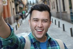 Cute man taking a selfie outdoors royalty free stock images