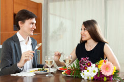 Cute man and woman having romantic dinner Stock Images