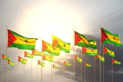 Cute many Sao Tome and Principe flags in a row on sunset with free space for your text - any feast flag 3d illustration. Nice any occasion flag 3d illustration stock illustration