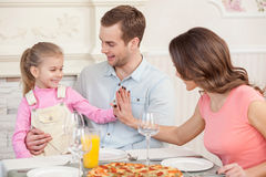 Cute married couple and child have a dinner Stock Photo