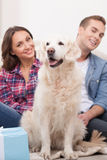 Cute married couple with their pretty dog Royalty Free Stock Photo