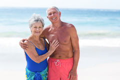Cute mature couple embracing on the beach Royalty Free Stock Image
