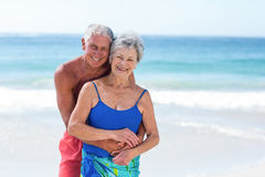 Cute mature couple embracing on the beach Royalty Free Stock Photography