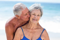 Cute mature couple embracing on the beach Royalty Free Stock Images