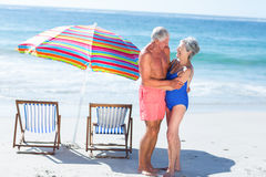 Cute mature couple hugging on the beach Royalty Free Stock Photography