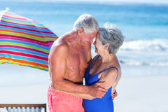 Cute mature couple hugging on the beach. On a sunny day Royalty Free Stock Photos