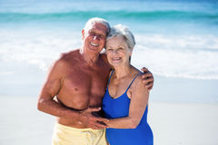 Cute mature couple hugging on the beach. On a sunny day Stock Photography
