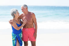 Cute mature couple looking at each other. On the beach Stock Photo