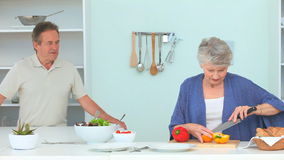 Cute mature couple preparing the dinner stock video