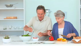 Cute mature couple preparing the dinner stock footage