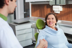 Cute mature lady is visiting the orthodontist Stock Photo