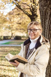 Cute mature woman in autumn park Stock Image