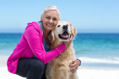 Cute mature woman petting her dog Stock Image