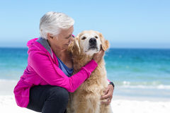 Cute mature woman petting her dog Stock Photos