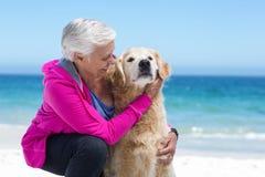 Cute mature woman petting her dog Stock Photos