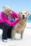 Cute mature woman petting her dog Stock Photo
