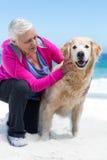 Cute mature woman petting her dog Stock Photo