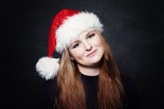 Cute Mature Woman in Santa Hat Royalty Free Stock Photos