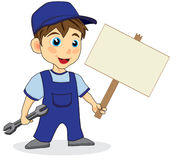 Cute mechanic boy holding a wood sign Stock Images