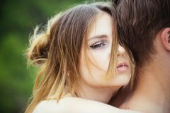 Cute man and woman are dating. Love and tenderness. Romantic couple embrace. Valentines day. Date of beautiful couple. Cute men and women are dating. Love and royalty free stock images