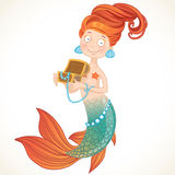 Cute mermaid holding a chest with pearls Royalty Free Stock Photos