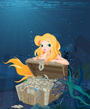 Cute Mermaid Over a Treasure Chest Stock Photography