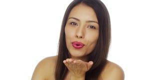 Cute Mexican woman blowing a kiss at camera Royalty Free Stock Photo