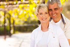 Cute mid age couple. Outdoors looking at the camera Royalty Free Stock Photography