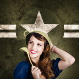 Cute military pin-up woman on army star background Stock Photos