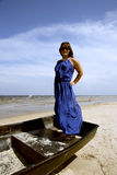 Cute miniature brunette stands in a boat Royalty Free Stock Photos